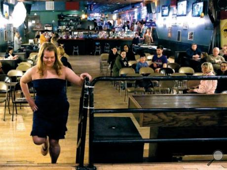 Wanda Breiner makes her way to the stage during a fashion show held by Covert's Closet, a Bloomsburg shop, Sunday at the Capitol Restaurant in Bloomsburg. The Capitol co-sponsored the show as a fundraiser for Beyond Violence, a Berwick-based women's shelter. This the first such event for the businesses, but organizers said they hope to make it annual.