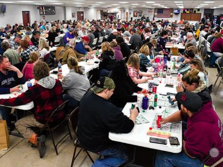 A sold-out crowd of 300 players fills the Espy Fire Hall for a firefighters' benefit handgun bingo Sunday afternoon. Organizers estimate a total of $11,500 worth of firearms were won by the bingo players in the course of the day.