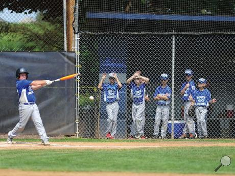 Players from the South Columbia Little League team watch their teammate Dylan Seely, left, hit the ball during the bottom of the first inning of Sunday afternoon's Little League Minor Division game against Lewisburg at Ber-Vaughn Park in Berwick.
