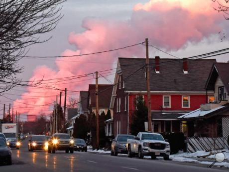 Steam from the Susquehanna Steam Electric Station cooling towers looks pink from the sunset as seen from East Second Street in Berwick on Tuesday.