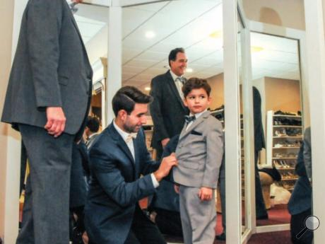 The Adams family of Mifflinville, representing three generations, is seen in photo at left. Dr. David Adams, left, Luke, and 4-year-old Jack were making some final adjustments to their apparel before the first fashion show Sunday. It was presented by Exclusively You of Bloomsburg at Caldwell Consistory in Bloomsburg.