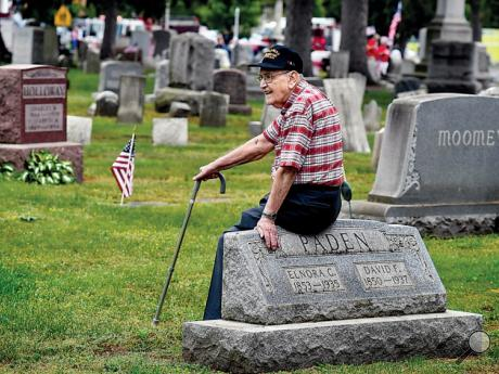 World War II Navy veteran Maurice Ford, 93, waits in the Pine Grove Cemetery in Berwick for participants in the Berwick-Nescopeck Memorial Day parade to arrive for the service in the cemetery Sunday. He said he had three brothers who also served during WWII. He is the only one still living.