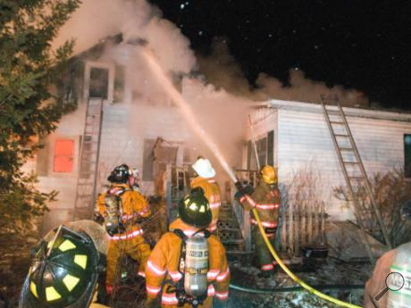 Firefighters from several communities in northern Columbia County battle a stubborn blaze at 616 Rohrsburg Road in Greenwood Township just after 8 Sunday night. The main part of the house appeared to be gutted.