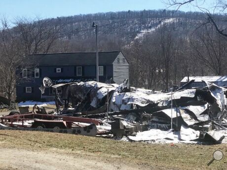 A barn at 293 S&H Ave. in Riverside is destroyed after a 1 a.m. fire Sunday. Fire officials believe the blaze started in a chimney for a wood-burning stove. The converted corn crib was used for storage and as a gathering place.