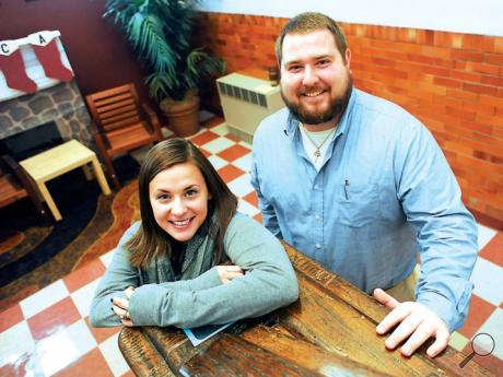 Berwick YMCA Reach & Rise Mentoring program's Allison Everett, left, and Brandon Berkes stand on the landing between the first and second floors of the Berwick YMCA. The program recently won a grant to create a new team-mentoring program.