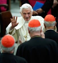 This Nov. 26, 2011 AP file photo shows Pope Benedict XVI waving as he leaves Paul VI hall after attending a concert of the Asturias Principality Symphony Orchestra directed by Chilean conductor Maximiano Valdes, at the Vatican. On Monday, Feb. 11, 2013 the Vatican announced that Pope Benedict XVI will resign on Feb. 28, 2013.