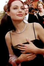 Less than two weeks after Angelina Jolie had a double mastectomy to avoid breast cancer, her aunt has died from the disease. Jolie's aunt Debbie Martin died at age 61 Sunday in a San Diego-area hospital, her husband Ron Martin tells The Associated Press. Debbie Martin was the younger sister of Jolie's mother Marcheline Bertrand, whose own death from cancer in 2007 inspired the surgery that Jolie described in a May 14 New York Times op-ed. (AP Photo/Damian Dovarganes, File)