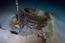 This image provided by Bezos Expeditions shows a thrust chamber of an Apollo F-1 engine on the bottom of the Atlantic Ocean in March 2013. An expedition led by Amazon CEO Jeff Bezos pulled up two rocket engines, including this one, that helped boost Apollo astronauts to the moon. Bezos and NASA announced the recovery on Wednesday, March 19, 2013. The sunken engines were part of the Saturn V rocket used to bring astronauts to the moon during the 1960s and 1970s. After liftoff, they fell into the ocean as pla