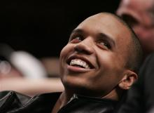 This is a Tuesday, March 21, 2006 file photo of professional poker player Phil Ivey as he relaxes during a timeout in the third quarter of NBA basketball action between the New York Knicks and the Toronto Raptors at Madison Square Garden in New York. A casino group has accused U.S. professional poker star Phil Ivey of cheating at baccarat and says the alleged scam means they don't have to pay his claimed multimillion dollar winnings. The Genting Group said in court papers filed Tuesday May 14, 2013 t