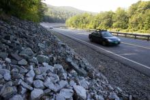 In this Aug. 22, 2013 photo, cars travel on the rebuilt Vermont Route 107 in Bethel, Vt. After rising for decades, total vehicle use in the U.S. peaked in August 2007. It then dropped sharply during the Great Recession and has largely plateaued since. (AP Photo/Toby Talbot)