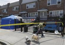 "A woman ducks under crime-scene tape near the one-time home of famous gangster Jimmy Burke, Tuesday in New York. Burke, a Lucchese crime family associate known as ""Jimmy the Gent,"" was the inspiration for Robert De Niro's character in the 1990 Martin Scorsese movie ""Goodfellas."" Burke died behind bars in 1996, two decades after authorities say he masterminded a nearly $6 million robbery at New York's Kennedy Airport, one of the largest cash thefts in American history. (AP Photo/Kathy Willens)"