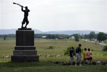 In this Wednesday June 5, 2013 photo, a monument sits atop a ridge held by Union troops, above the field of Pickett's Charge, in Gettysburg, Pa. This year's Gettysburg commemoration will represent the pinnacle of the re-enactment careers of thousands of Civil War buffs. Tens of thousands of visitors are expected for the 10-day schedule of events that begin June 29 to mark the 150th anniversary of the Battle of Gettysburg. (AP Photo/Matt Rourke)