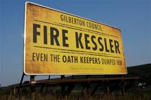 "A billboard paid for by The Coaltion to Stop Gun Violence that says: ""Gilberton Council: Fire Kessler Even The Oath Keepers Dumped Him"" is on Rt. 924 in the northbound lane outside of the Gilberton, Pa. exit Tuesday evening, August 20, 2013. Gilberton Police Chief Mark Kessler was suspended for thirty days after videos showing him cursing and firing automatic weapons. (AP Photo/The Republican Herald, Jacqueline Dormer)"