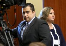 FILE - In this Monday, June 24, 2013 file photo, George Zimmerman, left, arrives in Seminole circuit court with his wife, Shellie, on the 11th day of his trial, in Sanford, Fla. She filed for divorce Thursday. (AP Photo/Orlando Sentinel, Joe Burbank, File)
