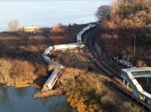 "Cars from a Metro-North passenger train are scattered after the train derailed in the Bronx borough of New York, Sunday, Dec. 1, 2013. The Fire Department of New York says there are ""multiple injuries"" in the train derailment, and 130 firefighters are on the scene. Metropolitan Transportation Authority police say the train derailed near the Spuyten Duyvil station. (AP Photo/Edwin Valero)"
