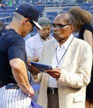 Bernando LaPallo, right, talks with New York Yankees manager Joe Girardi during batting practice before a baseball game against the Boston Red Sox at Yankee Stadium in New York, Saturday, June 1, 2013. (AP Photo/Paul J. Bereswill)