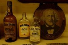 Inside the West Overton Museum, bottles of Old Overholt Rye Whiskey, which date before the 1940s, are on display in the turn-of-the-century mill house on Monday afternoon May 9, 2005. The mill used to make whiskey along with mill local farmer's grains.