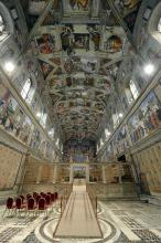 This picture made available Tuesday, March 12, 2013 by the Vatican newspaper L'Osservatore Romano shows the Sistine Chapel set up for the beginning of the conclave, at the Vatican. Cardinals enter the Sistine Chapel on Tuesday to elect the next pope amid more upheaval and uncertainty than the Catholic Church has seen in decades: There's no front-runner, no indication how long voting will last and no sense that a single man has what it takes to fix the many problems. (AP Photo/L'Osservatore Romano, ho)