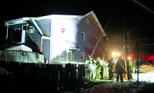 Firefighters stand by as a meth lab is investigated at a home on Chestnut Street in Berwick Thursday night. The meth lab was discovered Thursday afternoon.