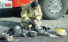 A Danville firefighter attempts to turn off some of his equipment after it froze Tuesday afternoon on Ash Street in the Borough. (Press Enterprise/Keith Haupt)