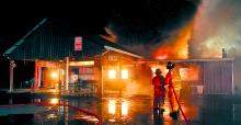 Firefighters try to contain flames as Creekside Family Restaurant in Orange Township is destroyed by fire early Sunday morning. (M.J. Mahon/Press Enterprise)