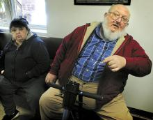 Carl Eugene Wolfgang, 56, Numidia, sits in his motorized wheelchair, on Thursday, while waiting to go before District Judge Craig Long in Catawissa on charges that he groped an 18-year-old home health aide. At left is his wife, Diane Wolfgang. (Press Enterprise/Bill Hughes)
