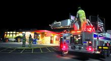 Firefighters respond to a fire call at Denny's restaurant Thursday night. (M.J. Mahon/Press Enterprise)