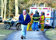 Jeffrey Cox walks away from an ambulance containing his son, also named Jeffrey, 13, and after the boy was injured in a UVT accident on the family property along Mill Road in Locust Township Tuesday.  Police say the boy was riding the utility vehicle in the woods with a friend when the earth gave way, causing him to tumble 50 feet or more.  He was taken by helicopter to the hospital.
