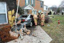 This Volkswagen smashed in this apartment rented by Don Fulmer at the Montgomery Village Apartments in Mahoning Township Friday afternoon. Fulmer was sitting on a chair just feet from the wall when the car hit the building. (Press Enterprise/Keith Haupt)