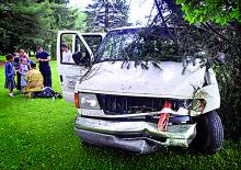 After crashing through fences, shrubs, a utility pole and a tree, a van carrying several children and driven by Jacob Thomas Konkolics, 18, of Espy, rests in a front yard along Old Berwick Road in South Centre Township on Tuesday morning. (Bill Hughes/Press Enterprise)