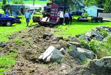 Dirt tracks are shown dug into a yard after a dump truck, towing a tractor failed to stop at the intersection of routes 487 and 93 in Orangeville Thursday afternoon. The accident damaged two parked vehicles as well. (Press Enterprise/M.J. Mahon)