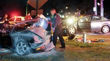 Police and medics work at the scene of a Lightstreet Road crash Friday night. (Press Enterprise/Jimmy May)