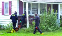 The State Police clandestine team enters a home at 9 Skyview Road in Catawissa Township to investigate a suspected meth lab Tuesday.