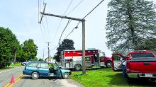 A man drove this Ford station wagon into a pole on East Main Street in Millville on Saturday afternoon. Witnesses and fire officials say he died in the wreck. (M.J. Mahon/Press Enterprise)