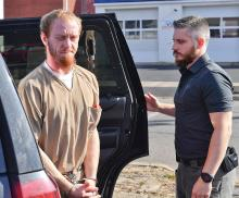 Christopher Wolf Lynn is brought out of a police SUV by Berwick Detective Reagan Rafferty before heading into District Judge Richard Knecht court in Berwick Wednesday afternoon.