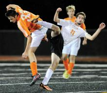 Danville's Tyler Deal, left, and Tunkhannock's Aidan Cronin fall to the turf after Deal heads the ball away. Cronin was called for a push on the play, during the first half of Tuesday night's state playoff game at Lake-Lehman. (Press Enterprise/Jimmy May)