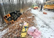 This school bus crashed and rolled onto its side after the driver hit a slick spot on top of Klein Road in Valley Township Tuesday morning. The 14 students on board were traveling to Columbia-Montour Vo-Tech.