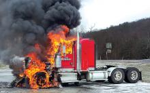 A Tom Bowman tractor goes up in flames Thursday afternoon in Orangeville. (Special to the Press Enterprise/Chad Zimmerman)