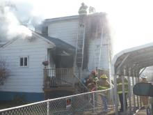 Firefighters battle a blaze at 109 Spruce St. in Danville Thursday. (Press Enterprise/Julye Wemple)