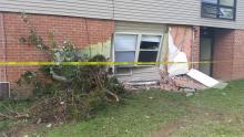 Damage to an Evergreen Pointe apartment building is shown, following an early morning crash.