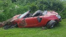 A Toyota MR2 after it was towed out of the brush where it landed upside down off of Back Branch Road. (Press Enterprise/Julye Wemple)