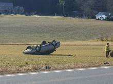 A car came to rest upside down in a cornfield Friday on Southern Drive. (Press Enterprise/Julye Wemple)