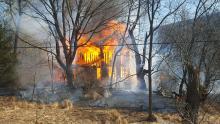 Fire consumes a house along Winding Road in Fishing Creek Township. (Press Enterprise/Julye Wemple)