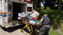 Luke Hunsinger Jr., 7, of Bloomsburg, is placed in ambulance after an ATV overturned on top of him and his great-grandfather, Jesse Tarr, 86, in Montour Township on Tuesday. (Press Enterprise/Leon Bogdan)