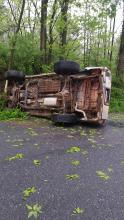 Hayley Davenport's Toyota 4Runner sits on its side following a crash Friday morning on Cryder's Lane in Bloomsburg.