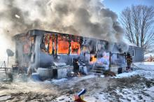 A firefighter battles a blaze at 46 Oriole Road, Greenwood Township. (Special to the Press Enterprise/Harry Watts)
