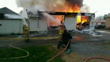 Flames rip through a garage at 20 Water St., Washingtonville. (Press Enterprise/Jimmy May)