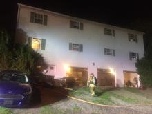 Firefighters doused a fire in the garage bays below apartments at 223 Lockard Ave. Thursday. (Press Enterprise/M.J. Mahon)