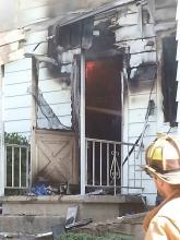 Firefighters battle a blaze at 351 E. First Street, Bloomsburg, Friday morning.