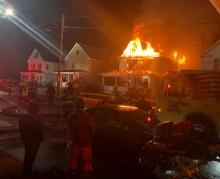 Flames shoot from the roof of 1324 Fairview Ave. on Monday morning. (Press Enterprise/Peter Kendron)